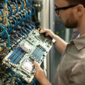 it-support-specialist-examining-motherboard-of-ser-SMKQY2C